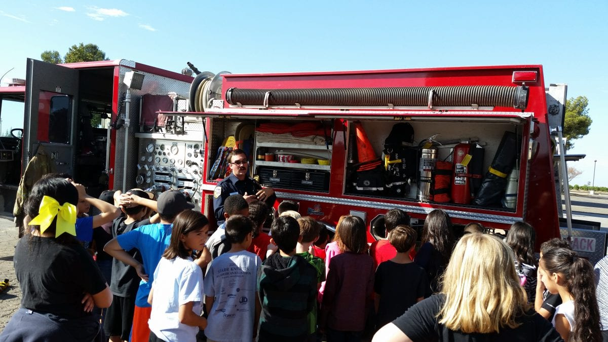 Cal Fire demonstrates their fire truck equipment to fourth grade students