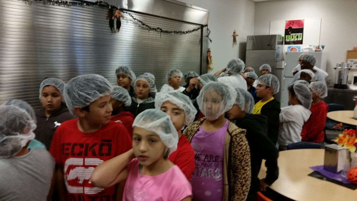 Students wear hair nets at the Fresno Unified Nutrition Center